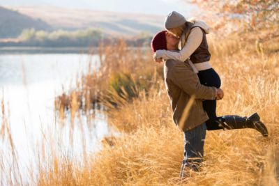 happy wife kissing husband