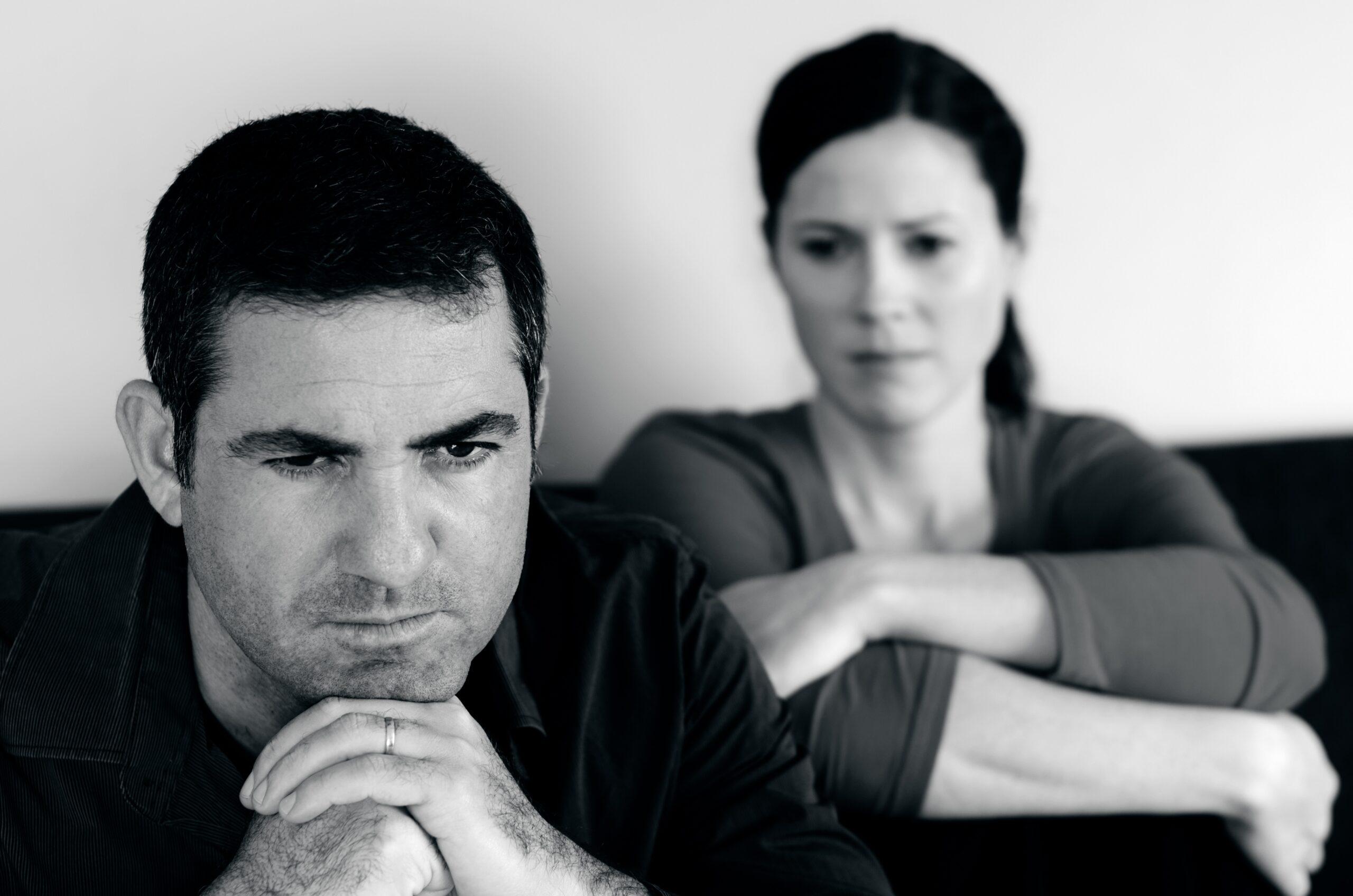 Unhappy husband upset wife